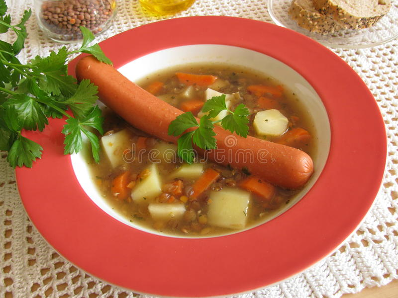 Lentil soup. With viennese sausages stock photos