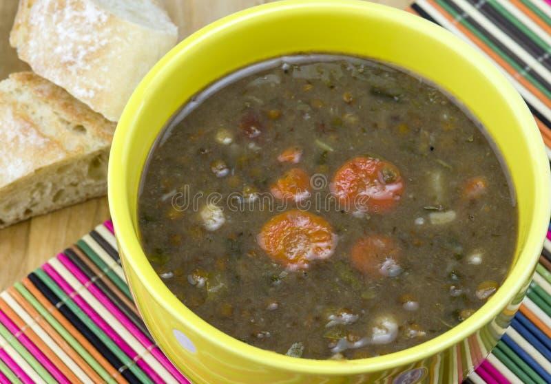Lentil soup. A bowl of hearty lentil soup stock photo
