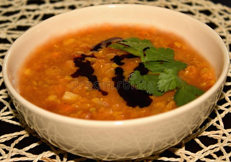 Detail of dense Lentil soup with tomatoes and carrot royalty free stock photography