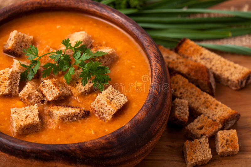 Lentil soup. In a wooden dish royalty free stock photos