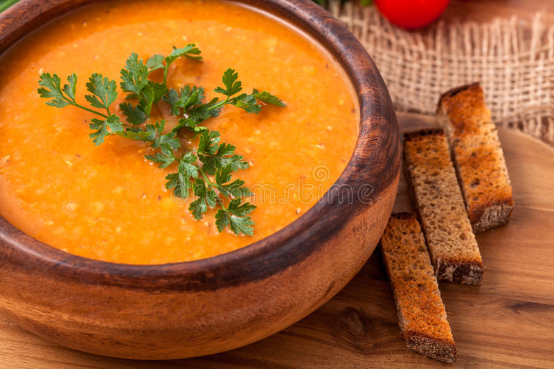 Lentil soup. In a wooden dish stock photos