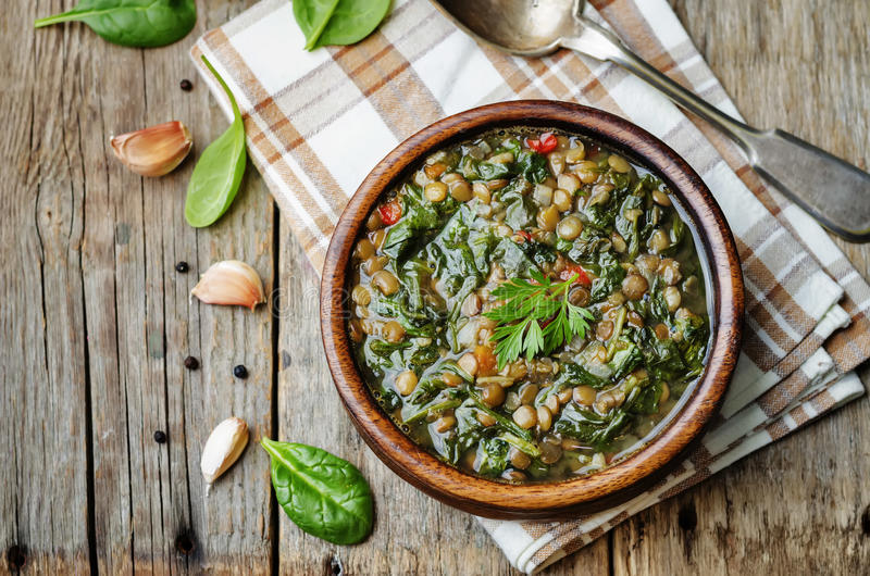 Lentil spinach soup. On a dark wood background. the toning. selective focus royalty free stock image