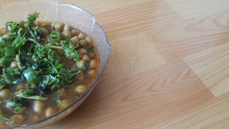 Lentilles traditionnelles Channa/Chola Masala ou cari de pois chiches ou bhature de chole photos libres de droits