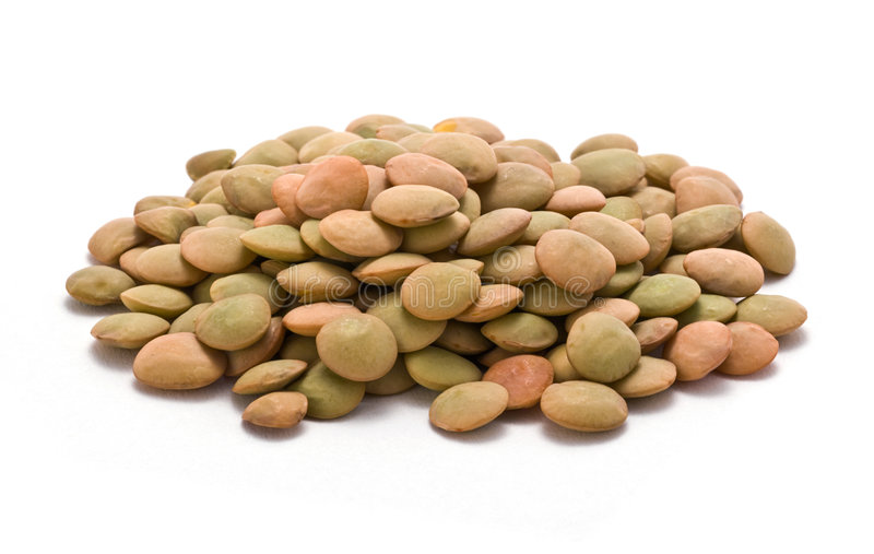Lentils. A pile of lentils on a white background stock photos