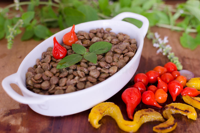 Lentils. Brazilian ingredients in wood table stock photo