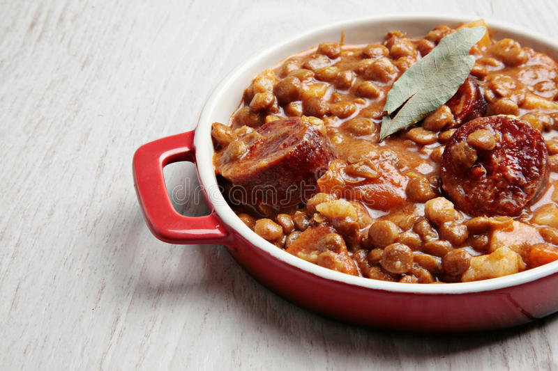 Lentils and chorizo stew. Traditional lentils and spanish chorizo stew royalty free stock photos