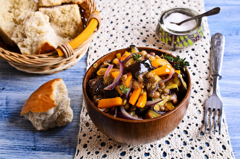 Lentils cooked with vegetables. Lentils cooked with capsicum, eggplant and onions royalty free stock photography