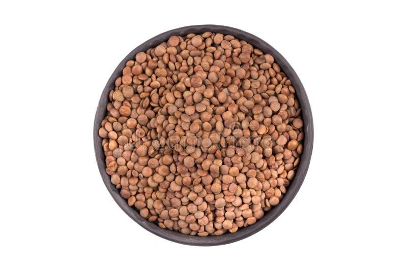 Lentils Isolated on White Background. Organic lentils in bowl Isolated on a white background - close up shot royalty free stock image