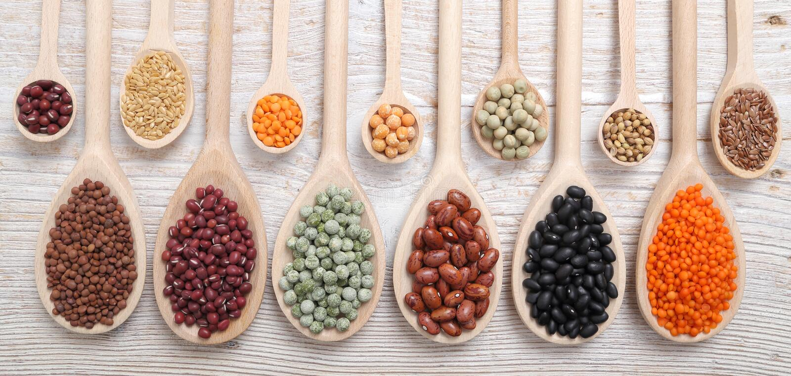Lentils, peas and beans. Lentils, peas and beans on wooden spoons stock images