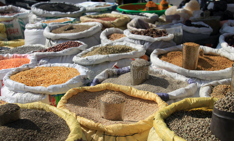 Lentils for sale. Sacks of lentils and spices for sale in a Nepalese market stock image