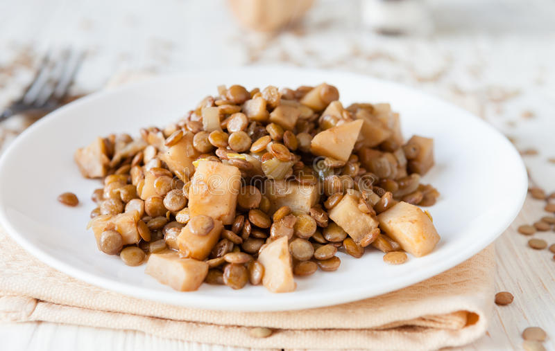 Lentils with steamed vegetables on a plate stock photo