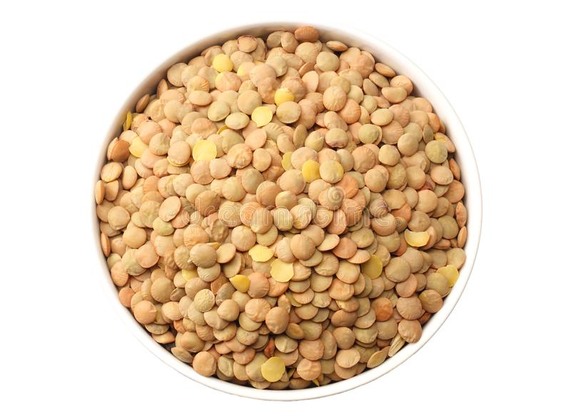 Lentils in a white plate isolated on white background. top view stock images