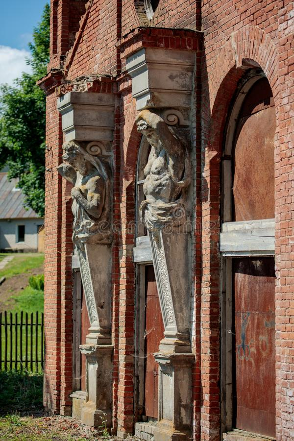 Lentvaris manor in Lithuania. Lentvaris, Lithuania - May 19, 2018: Architectural details of Lentvaris manor, XIX century manor, built in neo-gothic style, now royalty free stock photos