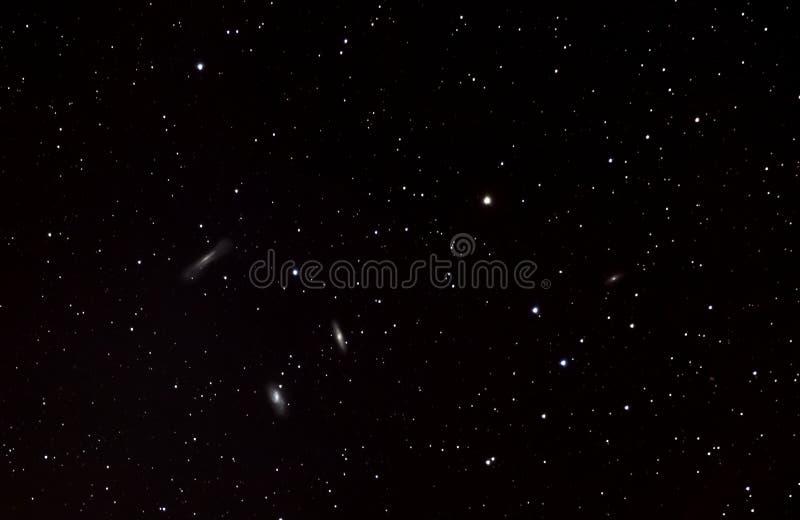 Leo Triplet In Dark Sky arkivfoto