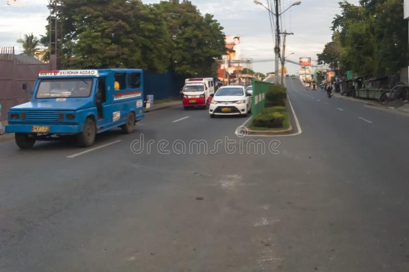Leon Garcia Street also known as Carpenter Road in Davao City, P. Hilippines - It also shows the usual traffic in this side of downtown Davao at 6 in the morning royalty free stock photo