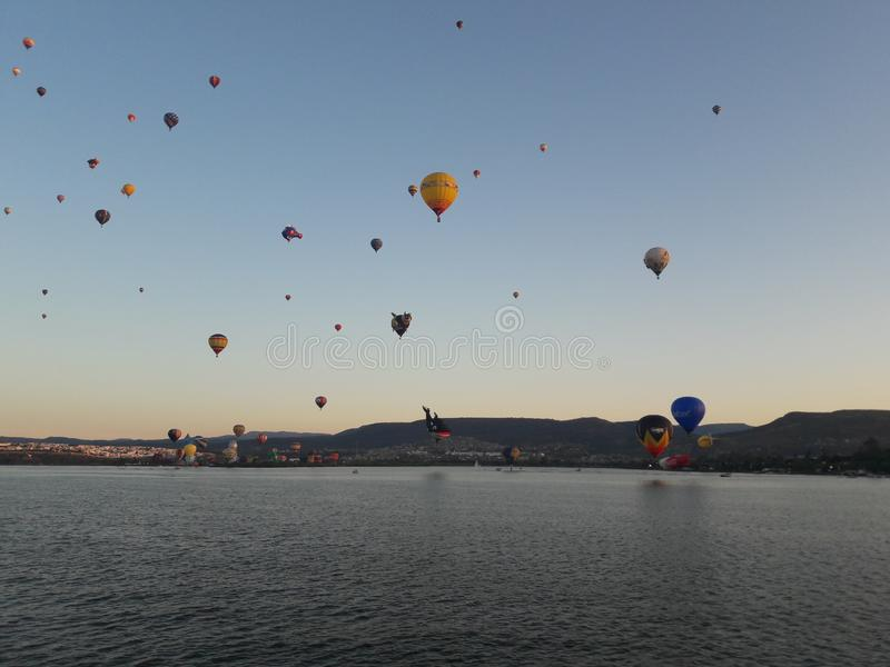 Leon Mexico International Hot Air Balloon Festival FIG. Lake, water, reflection, balloons, hills, travel, tourism, sunrise stock photos