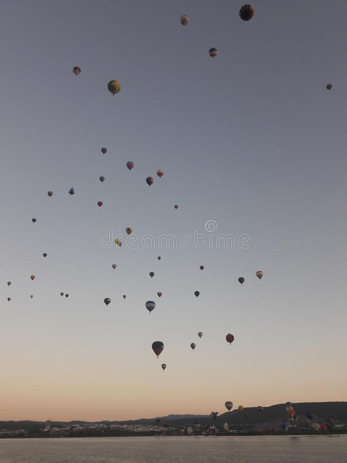Leon Mexico International Hot Air Balloon Festival FIG. Lake, water, reflection, balloons, hills, travel, tourism, sunrise stock images