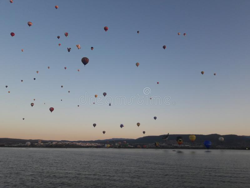 Leon Mexico International Hot Air Balloon Festival FIG. Lake, water, reflection, balloons, hills, travel, tourism, sunrise stock image