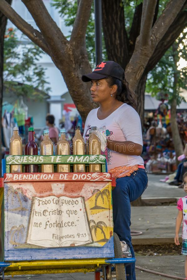 Leon, Nicaragua - March 10, 2018: Nicaraguan woman of scarce resources selling on the street stock photography