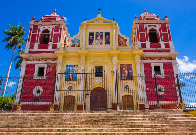 LEON, NICARAGUA, MAY, 16, 2018: Church with yellow facade blending pure neo classical lines and baroque decoration. Flanked by two side towers painted fake royalty free stock photos