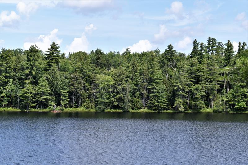 Leonard Pond, Colton,  St. Lawrence County, New York, United States. NY. US. USA. A landscape view of Leonard Pond, located near Tupper Lake in New York within royalty free stock image