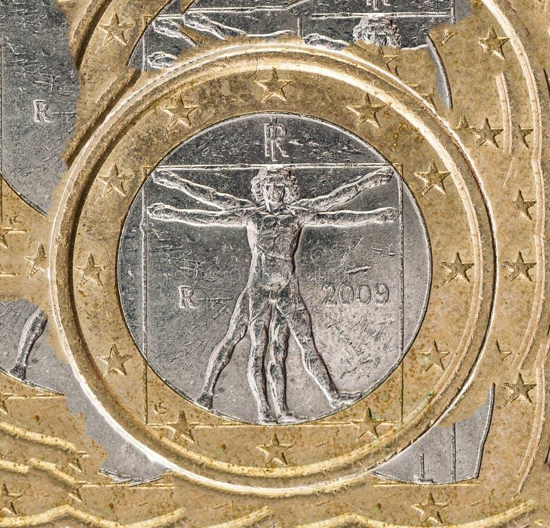 Leonardo Da Vinci Vetruvian Man una euro parte della moneta su bianco immagine stock