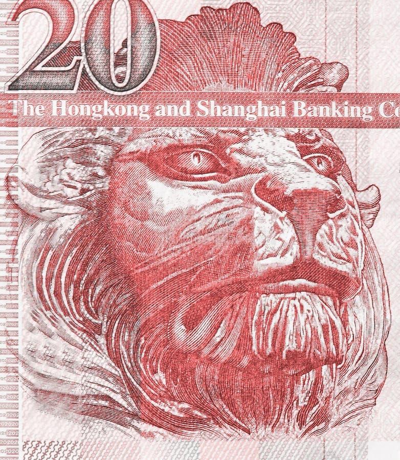 Leone britannico sul frammento di vecchio primo piano della banconota di venti Hong Kong Dollars immagine stock libera da diritti