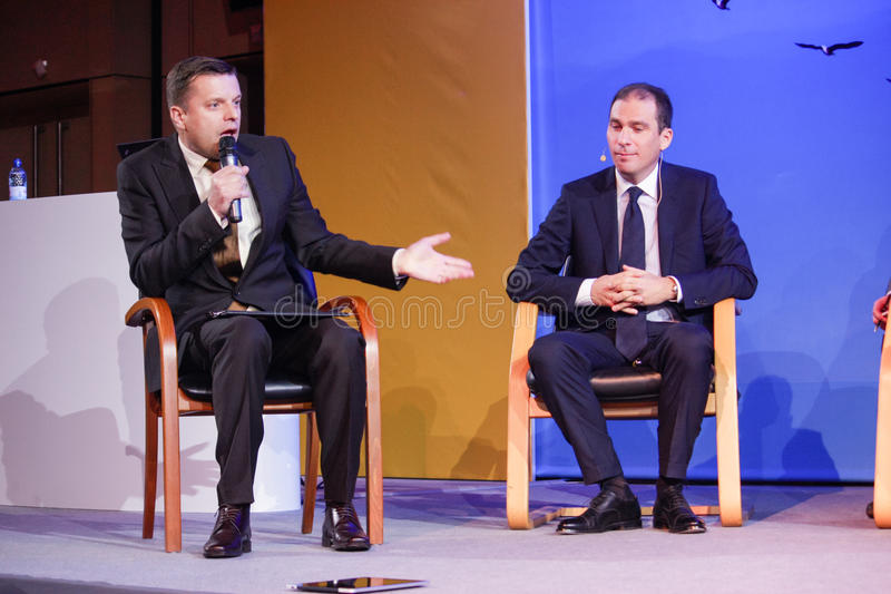 Leonid Parfenov (left) and Vladislav Martynov make panel discussion royalty free stock photos