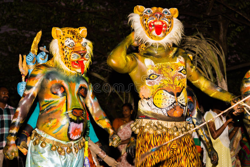 Leopard carnival costumes. Alleppey, India - December 26, 2015: Two person wear leopard costumes at Mullakkal Chirappu Festival. There are leopard masks on their stock photo