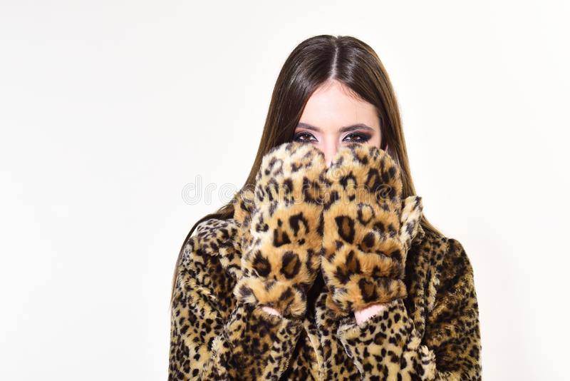 Leopard fur at stylish girl. leopard mittens and fur on pretty woman isolated on white. royalty free stock images