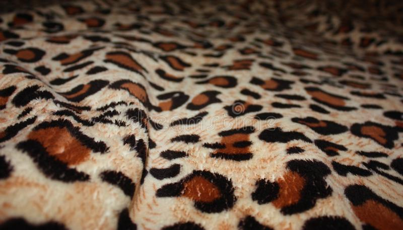 leopard pattern on fabric blanket stock image