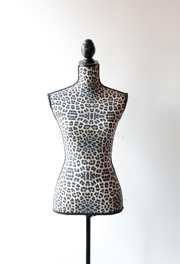 Leopard print mannequin. Dressmaker form stock images