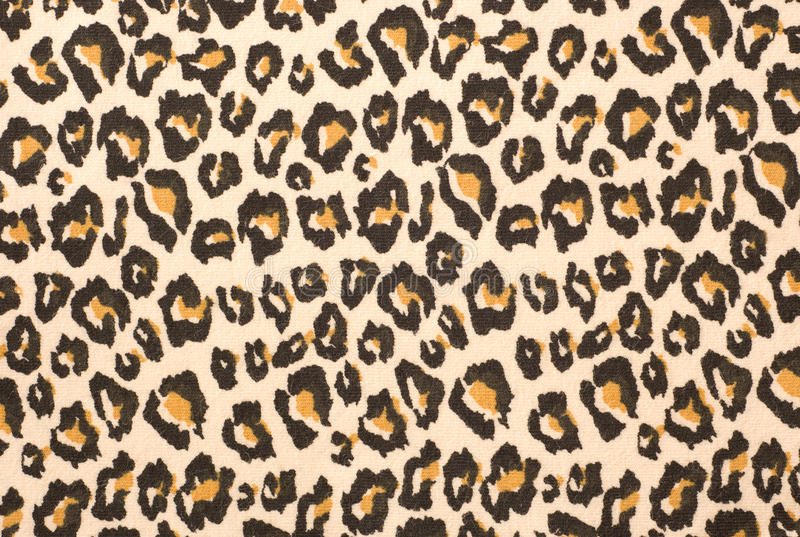 Leopard print textured background. A printed representation of the beautiful markings of a Leopard skin, this, on a piece of fabric royalty free stock image