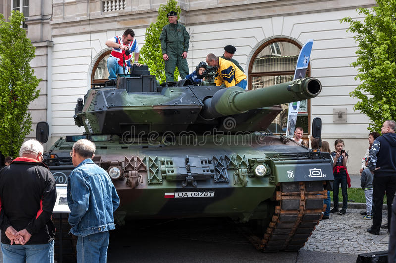 Leopard 2 tank, improved 2A5. WARSAW, POLAND - MAY 08, 2015: Leopard 2 tank, improved 2A5 version. People curiously looking and learning during the public stock photo