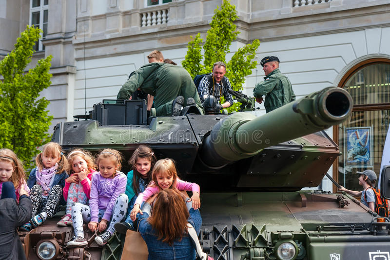 Leopard 2 tank. WARSAW, POLAND - MAY 08, 2015: Leopard 2 tank and children learning about army, during the public celebrations of 70th Anniversary of End of WW stock image