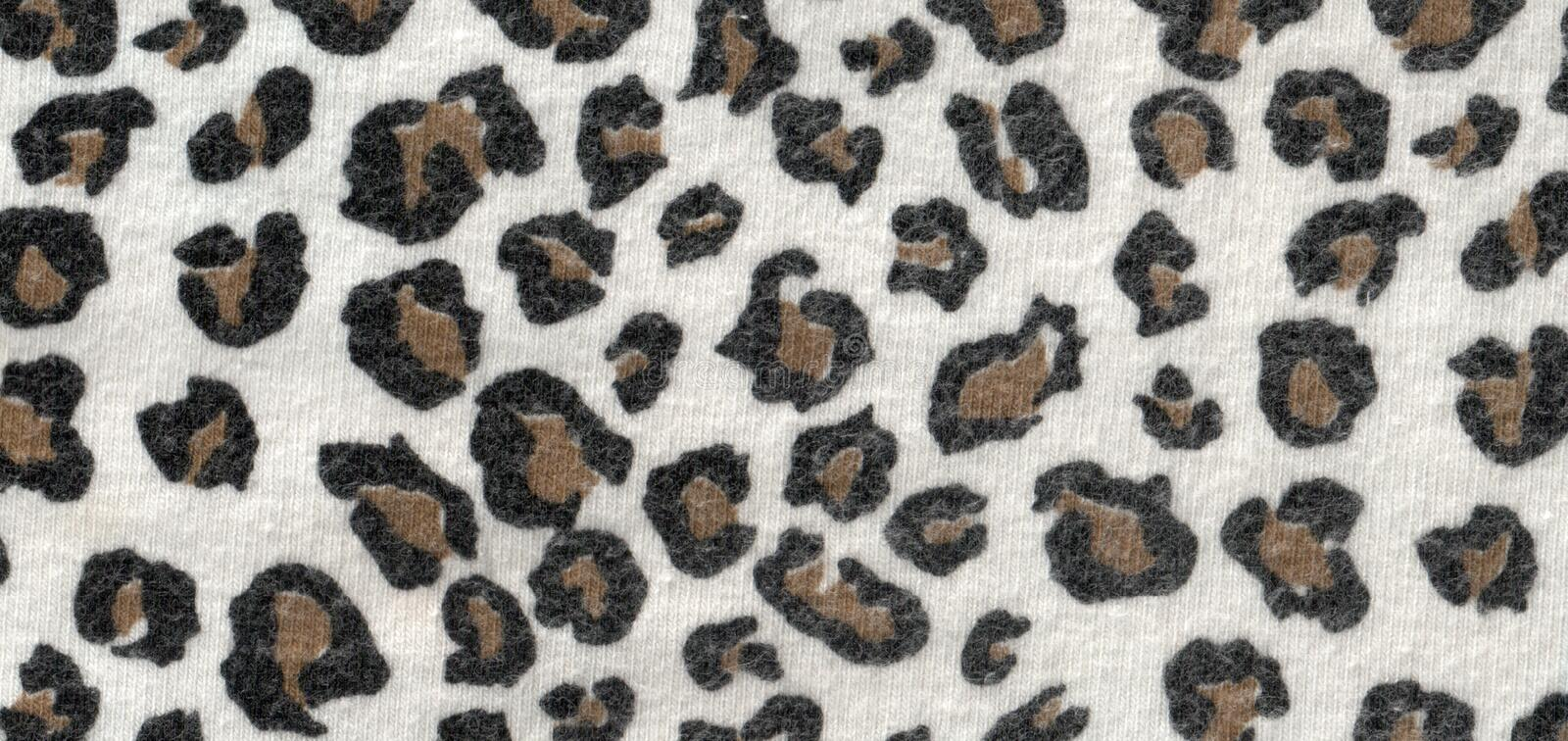 Leopard wool fabric. The texture of the wool fabric with a leopard print royalty free stock photo