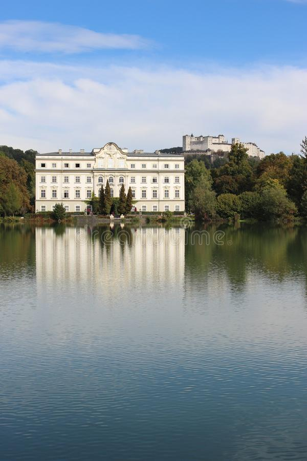 Leopoldskron Palace in Salzburg, Austria, Europe. Leopoldskron Palace in Salzburg, Austria, Europe, with fortress Hohensalzburg in the background. The Palace royalty free stock images
