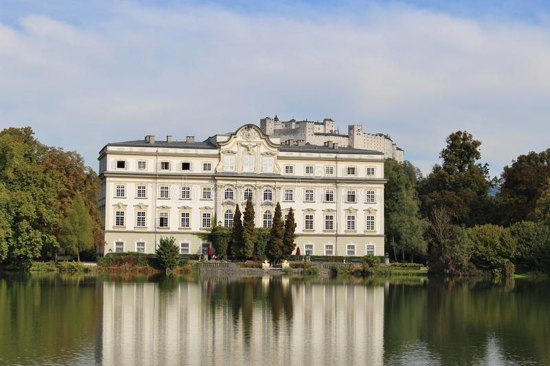 Leopoldskron Palace in Salzburg, Austria, Europe, with fortress Hohensalzburg in the background. The Palace was film location for the Musical Sound of Music royalty free stock images