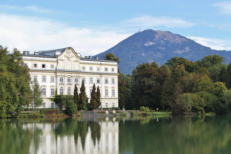 Leopoldskron Palace in Salzburg, Austria, Europe, with Gaisberg mountain. The Palace was film location for the Musical Sound of Music with Julie Andrews royalty free stock photo