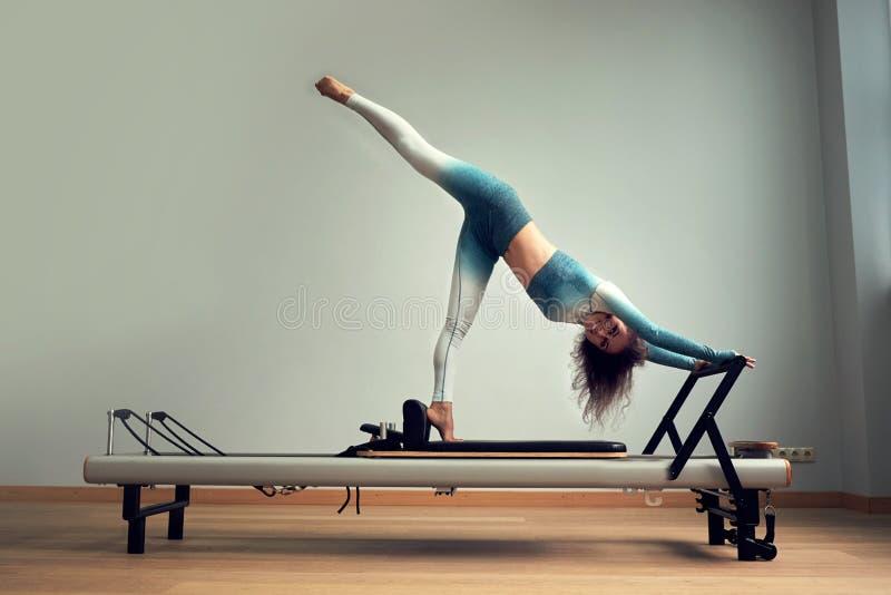 Leotard workout pilates training. athletic pilates reformer exercises. pilates machine equipment. young asian woman. Leotard workout pilates training. athletic stock photo
