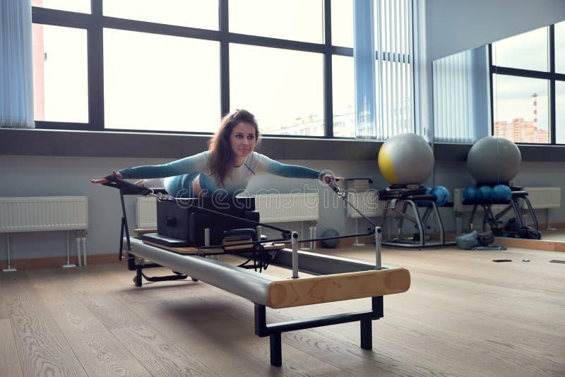 Leotard workout pilates training. athletic pilates reformer exercises. pilates machine equipment. young asian woman stock photo