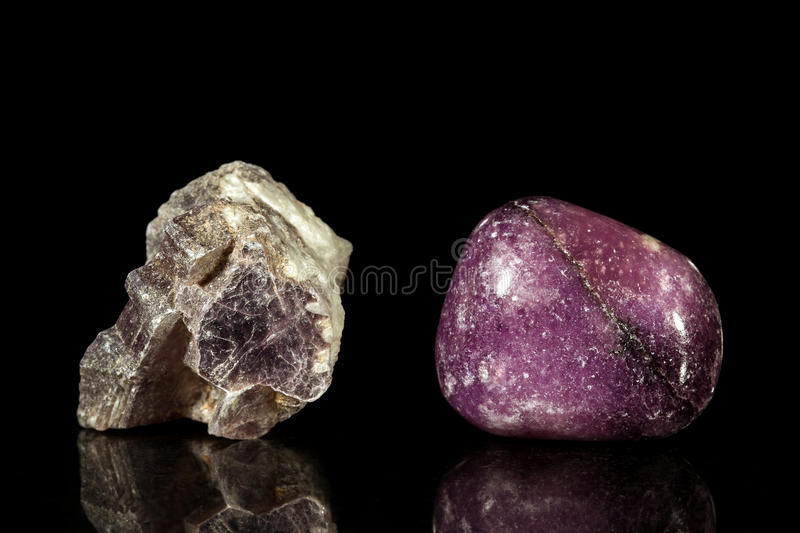 Lepidolite, uncut and Tumble finishing. With black background and reflection royalty free stock images