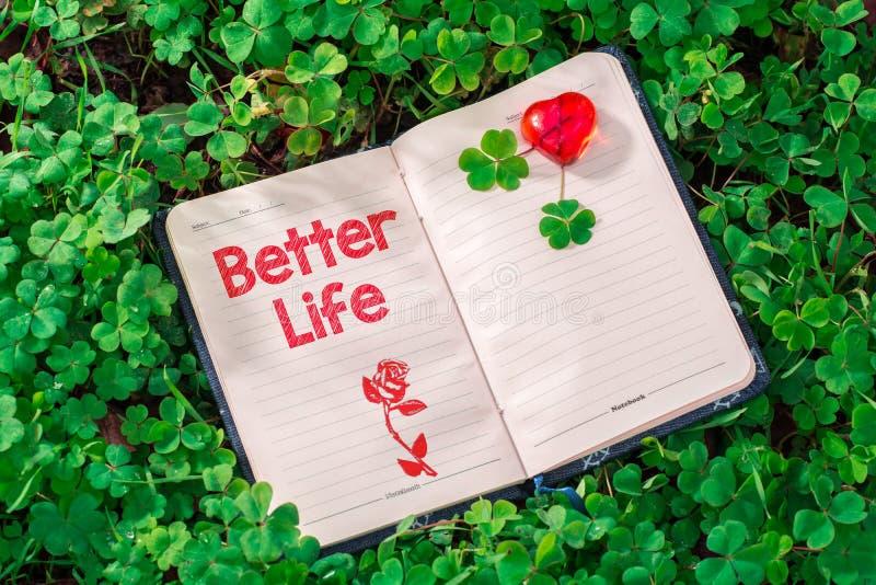 Lepszy życie tekst w notatniku obrazy stock