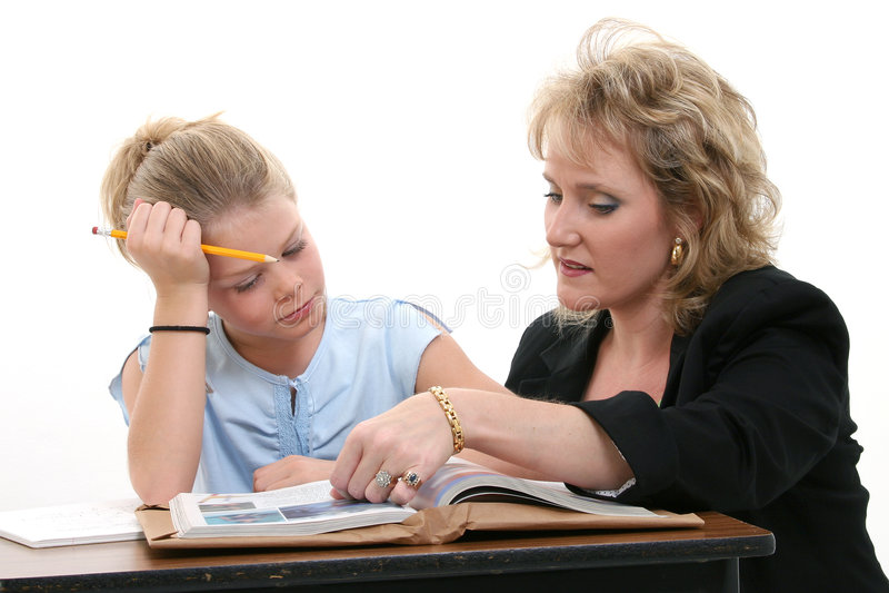 Leraar die Student helpt bij Bureau royalty-vrije stock afbeeldingen