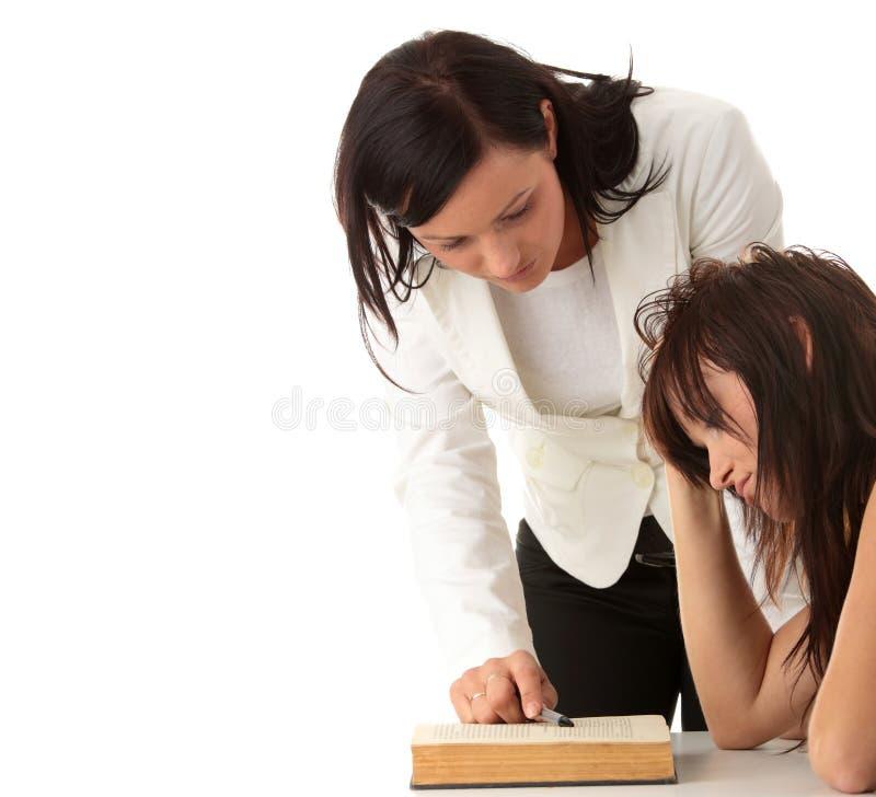 Leraar en student stock afbeeldingen