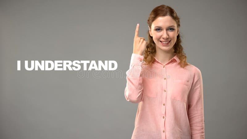 Leraar het zeggen begrijp ik in asl, tekst op achtergrond, mededeling voor doof stock foto's