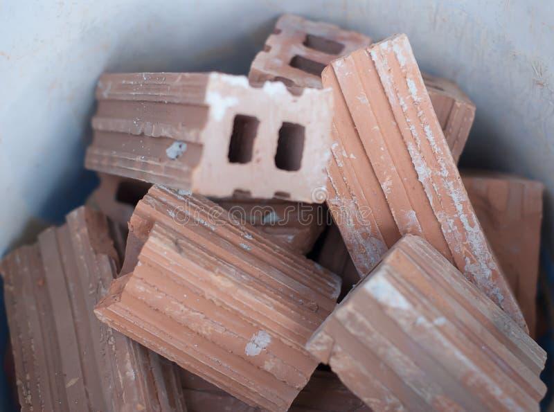 Lerategelsten för byggandevägg och staket arkivbilder