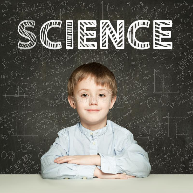 Lern Science. Clever student child on blackboard background with maths formulas royalty free stock photos
