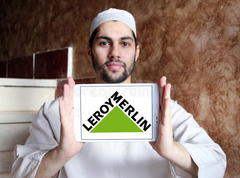 Leroy Merlin retailer logo. Logo of Leroy Merlin retailer on samsung tablet holded by arab muslim man. Leroy Merlin is a French headquartered home improvement stock image
