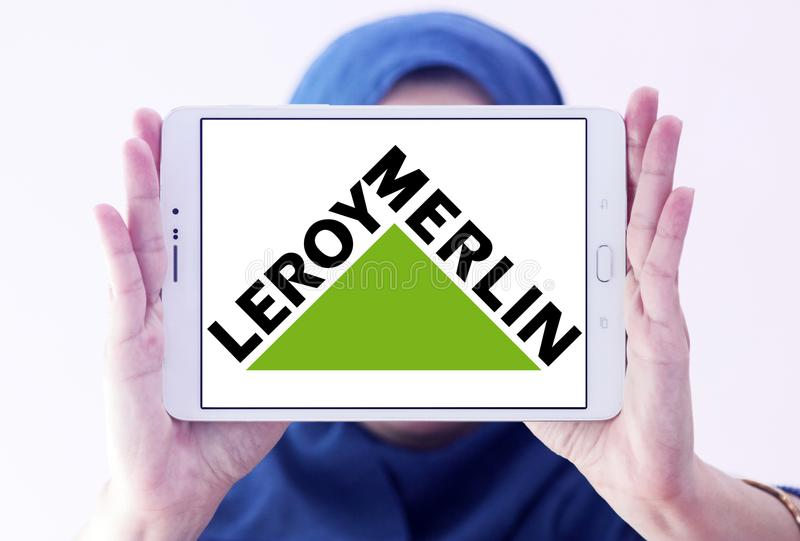 Leroy Merlin retailer logo. Logo of Leroy Merlin retailer on samsung tablet holded by arab muslim woman. Leroy Merlin is a French headquartered home improvement stock photos